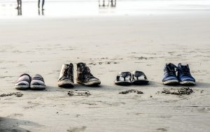 photo-of-assorted-pairs-of-footwear-on-sand-776219